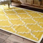 How to color coordinate using a yellow rug