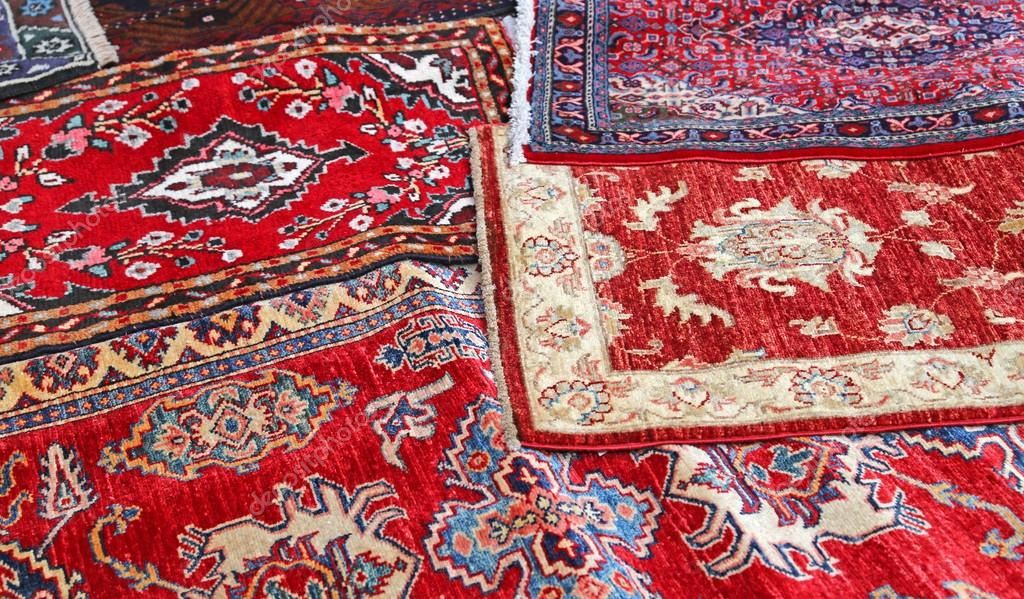 asian rugs for sale in the shop of fabrics and textiles - stock JEGSWTF