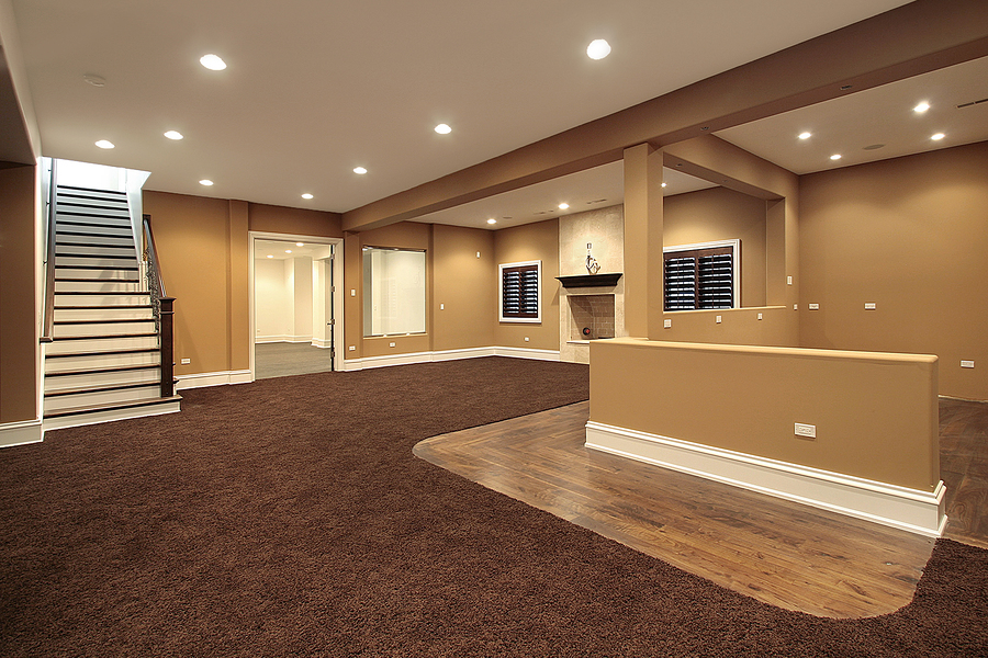 basement carpet lower level basement in earth tones and marble fireplace YJUDDEJ