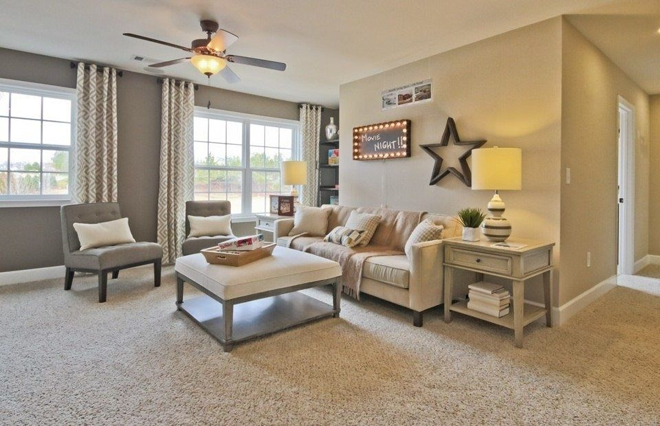 carpet designs for living room living room with medium beige frieze (twisted) carpet, flush light, ceiling  fan, EXXVKUX