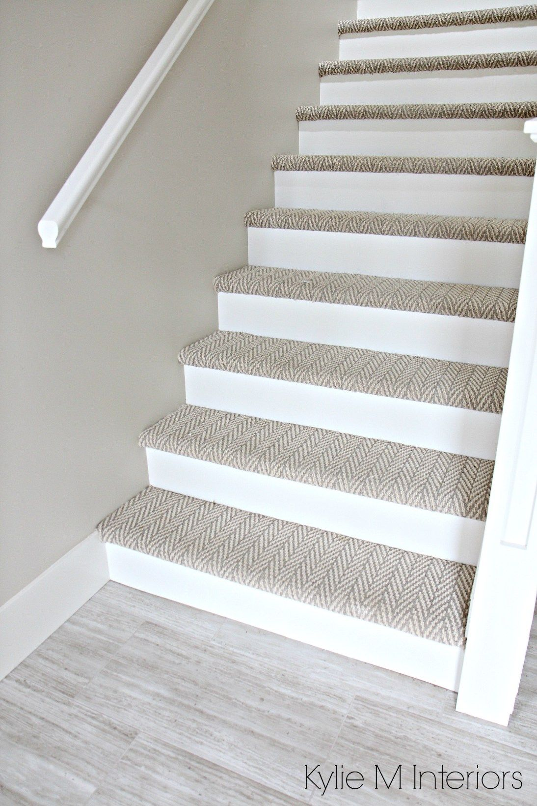 Carpet stairs stairs with carpet herringbone treads and painted white risers, looks like  a MMSJBPK