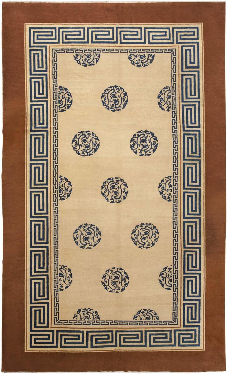 chinese rugs this phenomenal antique rug from china features precise fretwork borders  surrounding a MNUOSRH