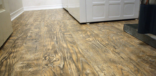 Floating laminate floor new laminate floor in laundry room. PBOCHJM