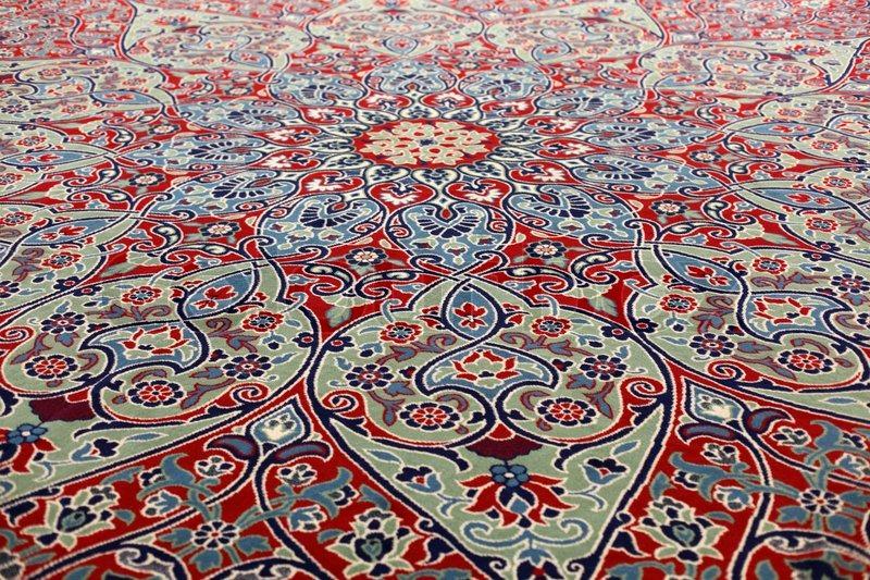 handmade carpets handmade carpet at the grand bazaar in istanbul, turkey | stock photo | VZHDEDG