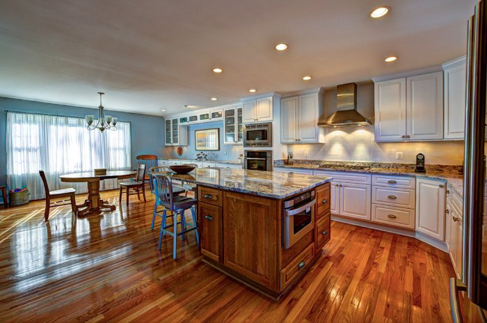 hardwood floors in kitchen large kitchen with island, kitchen table with wood flooring JBBBOUQ