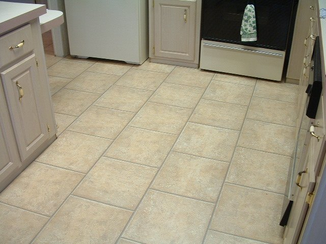 laminate tile flooring quick step laminate tile will be installed in this kitchen. this is the PLTFJET