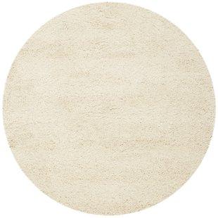round area rug mckeehan shag and flokati ivory area rug YGCGMTG