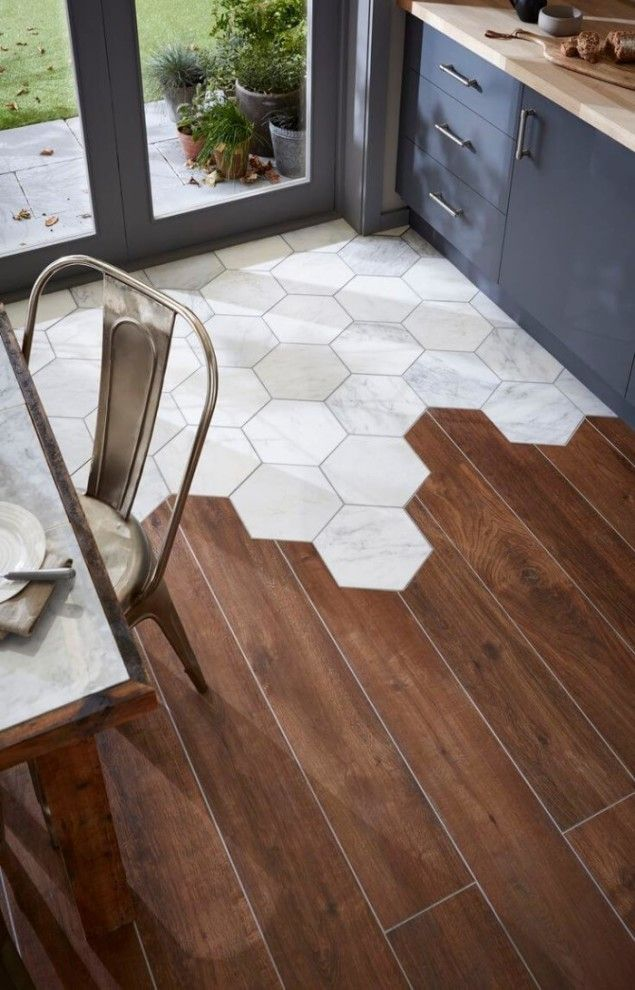 tile wood floor hexagon tiles meet traditional hardwood floors for a  stop-you-in-your-tracks look. the rest IBJTKVG