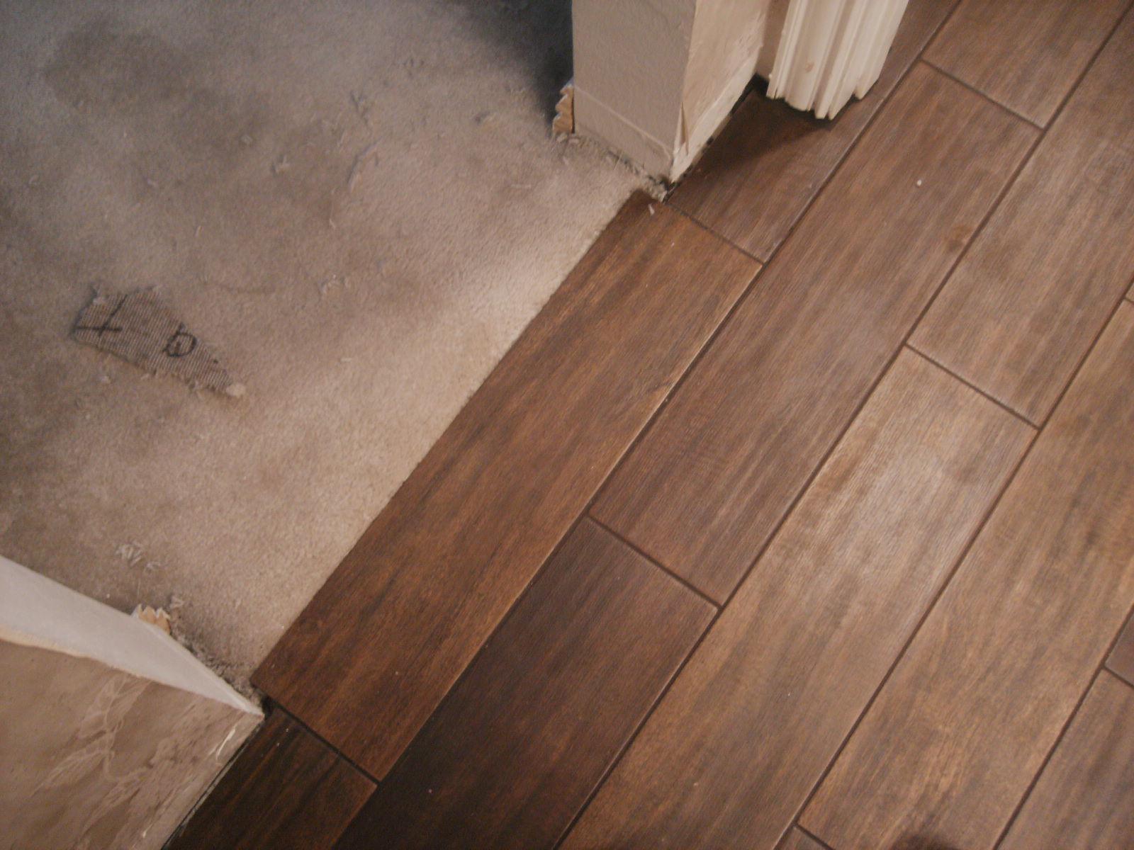wooden floor tiles quotis it wood flooringquot or quotis it porcelain tile ceramic wood tile YYNQZMO
