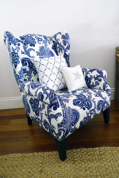 Wing chair upholstered in a blue and white Jacobean print | Blue