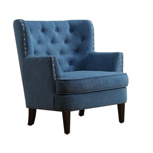 Use a blue occasional chair for your   extra living room chair