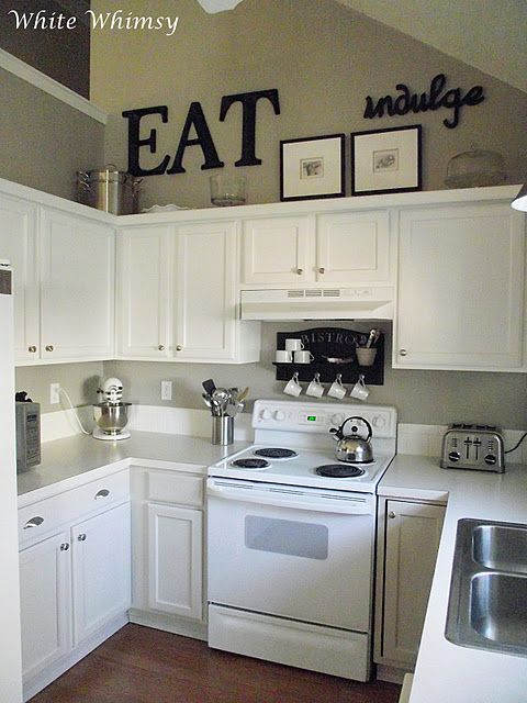 black accents, white cabinets! Really liking these small kitchens