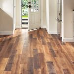 Choose laminate floors over stone and   hardwood
