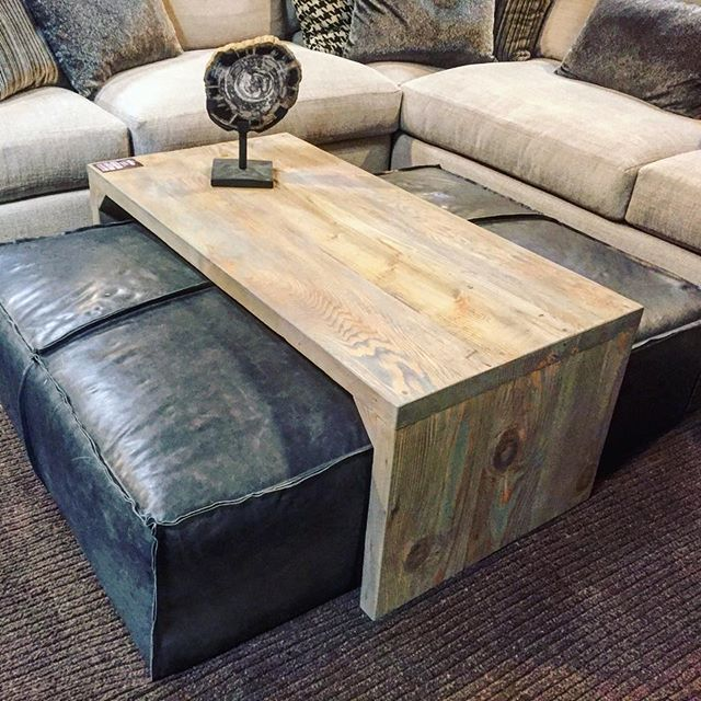 Leather ottoman/sliding wood coffee table. Super stylish and