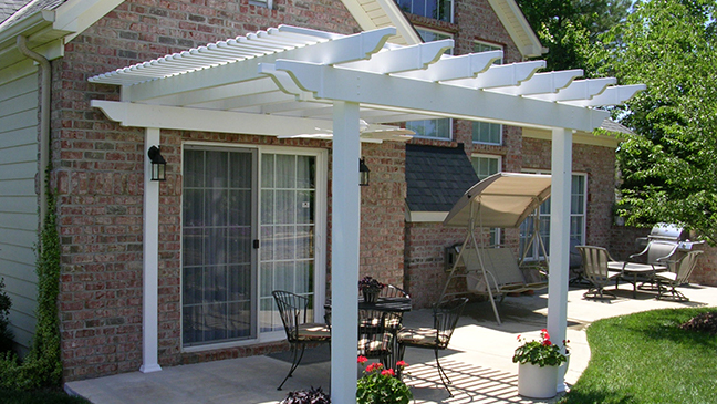 Patio Transformed with Attached Low Maintenance Vinyl Pergola Kit & Fan