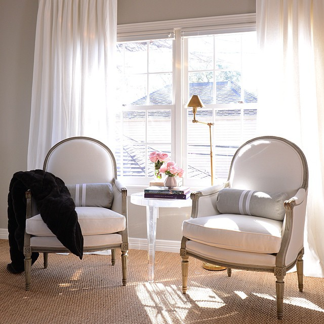 Bedroom Sitting Area with French Chairs and Lucite Table